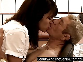 Young brunette Petra gives a blowjob to a old guy