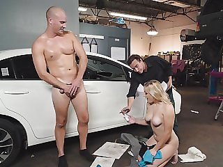 Busty blonde Daisy Lynne gives blowjob to a mechanic in the garage