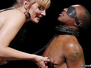 Black slave licking dominatrixs slit